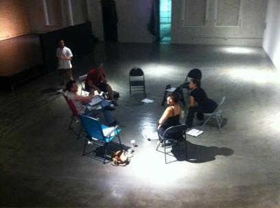 The ensemble doing some textwork in the 5000 sq. ft. front showroom space